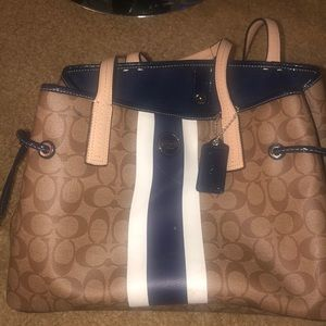 Beautiful coach bag with navy trimming